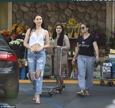 Rolling and strolling: Modern Family star Ariel Winter pushed a trolley as she…
