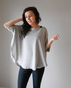 Poncho, cape, oversized sweater with curved hem and side vents, Light heather grey and black medium weight french terry knit, One size