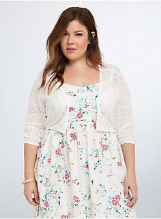 """<p>When you want to show off your new dress, but there's a nip in the air...this long sleeve shrug has you covered (but like actually). Ivory pointelle knit (eyelet holes that resemble lace) will instantly sweeten up your Sunday best.</p>  <p></p>  <p><b>Model is 5'9"""", size 1</b></p>  <ul> <li>Size 1 measures 20 1/2"""" from shoulder</li> <li>Cotton</li> <li>Wash cold, dry flat</li> <li>Imported plus size shrug</li> </ul>"""
