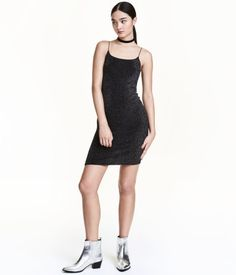 Black/silver-colored. Short, fitted dress with narrow shoulder straps. Lined.