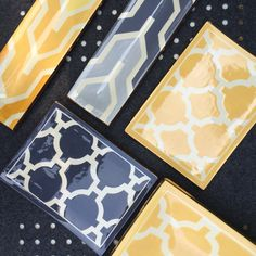 yellow and grey have by embedded in the design world ! these small trivet trays double as a vanity tray or individual serving tray. hand-thrown ceramics by a husband and wife duo from boston -trimmed in 14K gold and signed.  by jill rosenwald.