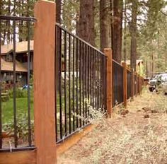 iron fence with wood posts and base
