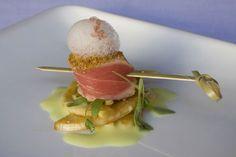 """Tuna Sashimi Lollie"", dusted with coriander on a fennel-cilantro salad with ponzu dressing, garnished with kaffir lime sauce, citrus foam, and volcanic Hawaiian sea salt,"