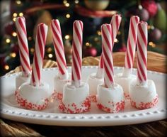 Hot cocoa Stir Sticks so easy to make:  Candy canes, into soft jumbo marshmallows, and dip in red sprinkles.
