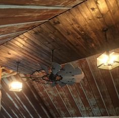 Rustic barn tin ceiling with windmill ceiling fan