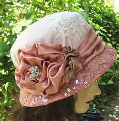 .Lovely and beautiful delicate pink and white satin and lace sequined hat.