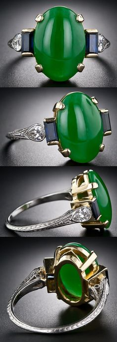 Vintage Natural Jade, Diamond and Sapphire Ring at Lang Antiques. A splendid, rich and even-colored, deep, bright-green natural cabochon jade, measuring 1/2 inch long by just over 3/8 inch wide, is dramatically presented in this 1930s ring. This jewel is elegantly and handcrafted in platinum and 18 carat yellow gold and sparkles on each shoulder with a sapphire baguette set perpendicular to a sparkling old-cut pear-shaped diamond. The tapered platinum shoulders and shank are hand engraved.