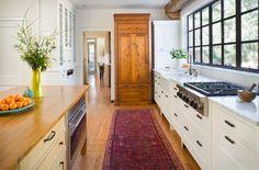 Antique cabinet as kitchen storage.