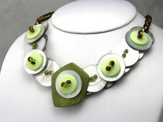 $45 Layered Mother of Pearl Button necklace!  Beautiful shades of green.  Two tones seed beads used to wrap around the back of your neck!