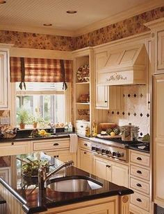 Black hardware on the cream colored cabinets is the only thing I like about this busy kitchen.