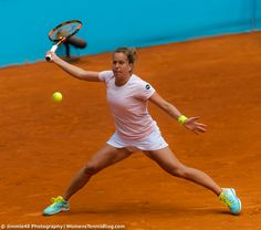 Barbora Strycova stretches on the Madrid clay en route to a first-round win over Bouchard, 2015
