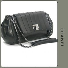 AUTHENTIC & VINTAGE CHANEL HANDBAG WITH SHW Authentic & vintage black calfskin CHANEL accordion bag with SHW. The sticker starts with 7****** produced in 2002. Inside burgundy leather lining, open pouch pocket & front flip closure. There is some discoloration on the flip latch which is reflected in price. The bag is in EUC with wrinkles & creases you would expect with aged skin. Vertical stitched line pattern adds some interest to the design. Comes with dust bag & free authentication. CHANEL…