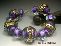 HANDMADE LAMPWORK BEAD Set by Donna Millard purple, gold, teal, organic assemblage.  https://www.etsy.com/listing/156138990
