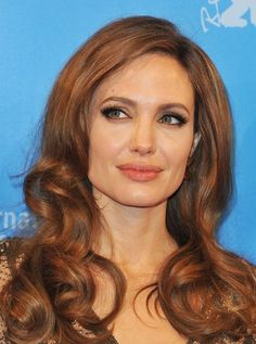 Celebrity Hairstyles For Women Over 40 - Angelina rocking the big curls too! They must be really in!