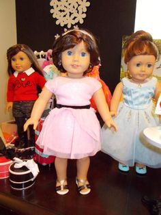 American Girl of the Year 2015 Lindsey in Grace's dress; Saige wearing Grace's blue shoes