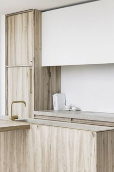 Check out this refreshing take on wooden kitchen cabinetry