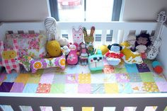 Handmade quilt and hand made toys for bebe.