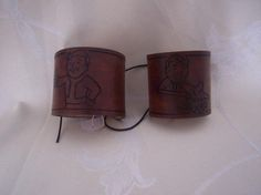 Hand made fallout 3 pip boy cuffs by Steam Generation   Made with 3mm veg tan leather, hand dyed and tooled