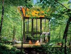 A Little Cabin Cantilevered Over a Rocky Ledge in the Mountains
