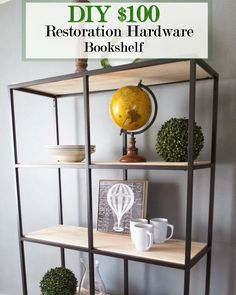 Make an iron and wood bookcase like the incredibly expensive ones from RH with an ikea shelf and plywood.  I think I would stain the plywood to a darker shade.