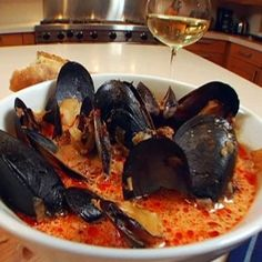 Spicy Mussels with Chorizo and Wine recipe from Melissa. d'Arabian via Food Network. I will use tomato puree' instead of harissa, I will also sub the chorizo out for Jimmy Dean's spicy sausage, and leave out the red pepper flakes. Shellfish Recipes, Seafood Recipes, Wine Recipes, Cooking Recipes, Garlic Recipes, Fish Dishes, Seafood Dishes, Fish And Seafood, Seafood Boil
