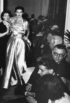 1948 Wenda Parkinson1948 Dior's the 'Winged Line', an assymetrical pearl-gray satin evening dress, is shown here at his salon, photo by Willy Maywald, Paris