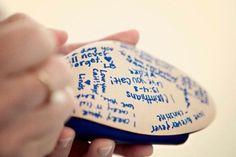 Bridesmaids write messages on the brides shoe - something blue! tcash819