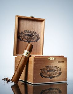 Gifts For the Man Who Has Everything - La Palina  These cigars, a wingback chair, and a bottle of good Scotch. His evening plans: Classic Robusto ($150 for a box of 20) by La Palina, smokeinn.com