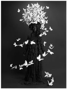 paper butterfly - Google Search ~~ So, the lady in the middle is a little creepy, but I love the idea of a swirl of butterflies for a display.