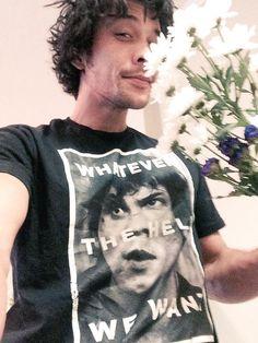 Bob. Smelling flowers. With a Bellamy Blake shirt.