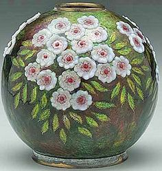 France~An enameled vase by C. Faure Limoges Rounded body on conforming foot ring~raised white and red floral blossoms~Brown~Green~Red ground~Circa 1920-1950