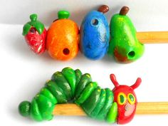 Very Hungry Caterpillar knitting needles from The Clay Bean Co. on etsy.com