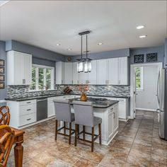 Bright and white updated kitchen renovation with Silestone countertops, island, tile flooring, custom cabinets and stainless steel appliances. Breakfast room off the kitchen with access to the expansive back deck. Listed in Annandale, Virginia for $899,900 by The Casey Samson Team is a Wall Street Journal Top Team in Northern Virginia.