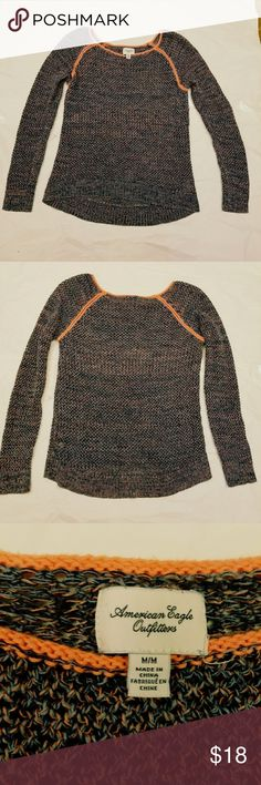 American Eagle knit sweater The knit is a navy and coral blended yarn in the body. You'd need to wear a cami underneath. Slight stretch to it. American Eagle Outfitters Sweaters Crew & Scoop Necks