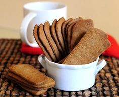 Speculoos are thin, crunchy, golden brown cookies that are traditionally baked and served around Christmas in much of Europe. The brown color comes from brown sugar, which gives the cookies most of th