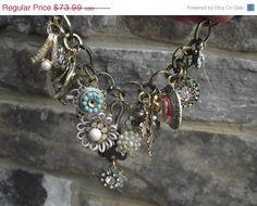 ON SALE SALE - Posh - Upcycled Vintage Brooch and Charm Bracelet. $62.89, via Etsy.