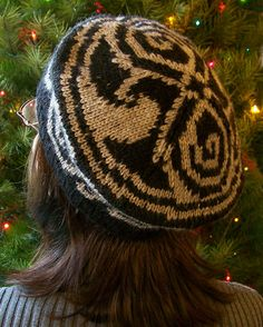 """This hat pattern is based on the Seal of Rassilon, a symbol of the Time Lords from the science fiction show """"Doctor Who."""" A Celtic knotwork border pattern has been added to the tam to complement the design of the Seal."""