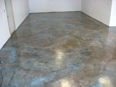 Decoratively stained concrete floor with multi-tone variegated effects using SoyCrete Concrete Stain. Sealed with EcoTuff High Traffic Clearcoat. Professionally installed by 2R Ecoproducts, Washington.