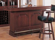 This cherry wood home bar is nicely detailed.   Check out the lower foot bar, which is a nice touch.