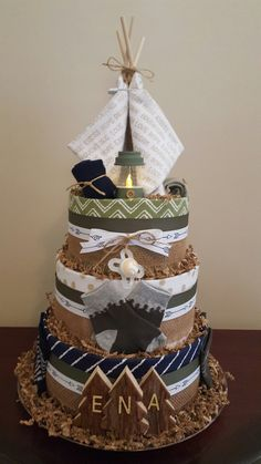 Camping themed diaper cake! Camping baby shower centerpiece gift.  So fun! Check out my Facebook page Simply Showers for more pics and orders.