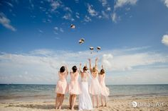 Bride and her bridesmaids with their bouquets at #MoonPalace @prweddings #DreamArtPhotography #DreamArtWeddings #WeddingPhotography #Wedding #DestinationWeddings #Photography #Cancun #CancunPhotography #Mexico #Bride #Bridesmaids #Bouquet #WeddingGown #Light #ColorPhotography #Color