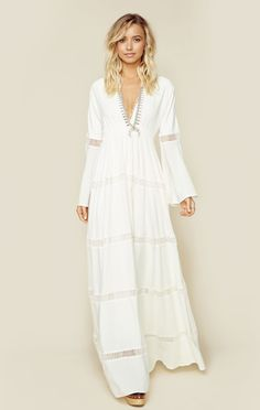 """The Hammock Maxi Dress by The Jetset Diaries features long bell sleeves, a plunging neckline, and full length skirt with lattice paneling throughout. Fully lined.  ImportedDry Clean OnlyViscose Rayon BlendFit Guide:Model is 5ft 9 inches; Bust: 32"""", Waist: 23"""", Hips: 34""""Model is wearing a size XSRelaxed FitShoes Featured Not Available For Purchase"""