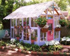 Ideas to Recycle Old Wood Windows for Green Building with Salvaged Wood and Glass Greenhouse from old windows and doors. Mexican roofing tiles frame bed of liriope and hydrangea. Old Window Greenhouse, Backyard Greenhouse, Greenhouse Plans, Greenhouse Wedding, Homemade Greenhouse, Cheap Greenhouse, Portable Greenhouse, Greenhouse Vegetables, Miniature Greenhouse