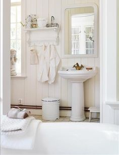 Simple white bathroom with ship lap walls, pedestal sink, and vintage accents. Seaside Bathroom, Simple Bathroom, Downstairs Bathroom, Bathroom Ideas, Bathroom Styling, Bathroom Photos, Design Bathroom, Bathroom Inspiration, Pedestal Sink