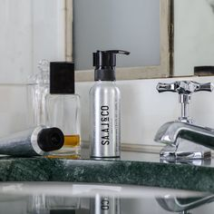 The essential products with some cologne and green marble in a stunning hotel bathroom. Inspired by Travel. Green Marble, Soap Dispenser, Cologne, Coffee Maker, Kitchen Appliances, Inspired, Bathroom, Travel, Products