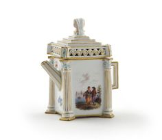 A small Meissen Architectural teapot and cover mid 19th century, one side painted with two figures in the foreground of a watery landscape, the other sides with flower sprays, the corners of the square-section body moulded with Corinthian columns, the reticulated cover surmounted with a double-faced bust, blue crossed swords mark, 11.5cm. (2)