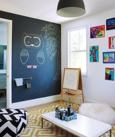 Children-specific pieces can be an eyesore, so the designers balanced the playroom's dark gray draw-on wall with some sophisticated but just-right-size accents.