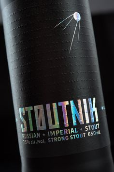Stoutnik Russian Imperial Stout, from Longwood Brewery. The label features a blind-embossed story about the beer told in morse code. Product naming, branding, and label design by Hired Guns Creative. Winner of a 2013 Applied Arts Award in the Beer, Wine & Spirits Packaging Design category.