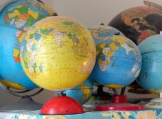 vintage globes on display