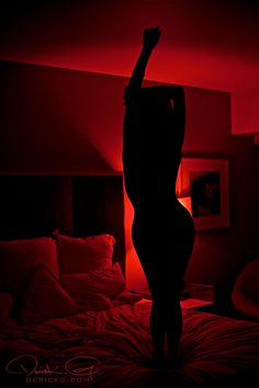 the red light seems to be coming from a lamp with a cover on it. it has a cone shape expanding as it reaches for the ceiling.-k